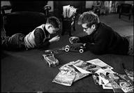 Dennis Stock, PAR128568 - playing with model car, 1955