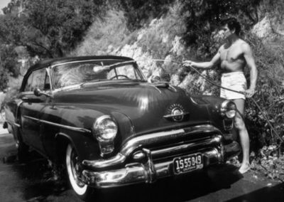 Sid Avery, Rock Hudson Washing His Car Outside His Hollywood Home, 1952
