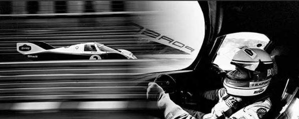 Werner Eisele, Markenweltmeisterschaft Hockenheim 1985, Cockpit des Porsche 956 von Hans-Joachim Stuck Stuck drückt auf den Auslöser als er den Lancia des Martini-Teams überholt - Stuck und Derrick Bell werden bei diesem Rennen Weltmeister - Galerie Stephen Hoffman, München